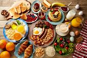 Breakfast buffet full continental and english coffee orange juice salad croissant fruit poster