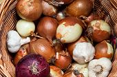 A Pile Of Bulb Onions In A Basket