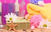 foto of bubble bath  - Bath Salts with Soap and Bubble Bath on Pink Background - JPG