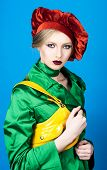 Portrait Of Blonde Girl With Makeup In Red Beret. Fashion Concept. Girl In Green Suit. Bright Makeup poster
