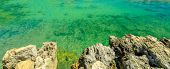 Background Texture Of Coastline Reef With Cliffs In Portugal With Clear Green Clear Water. Copy Spac poster