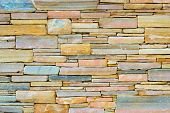 Decorative Stone Wall, Pieces Of Rock Bonded With Cement. Cobble Texture With Cracks. Mountain Of Ca poster