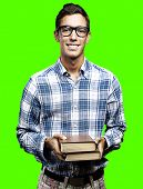portrait of young man holding books pile against a removable chroma key background