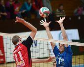 KAPOSVAR, HUNGARY - OCTOBER 29: Alpar Szabo (R) in action at a Hungarian National Championship volleyball game Kaposvar (blue) vs. Szolnok (red), October 29, 2011 in Kaposvar, Hungary.