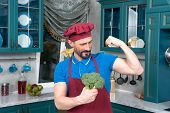 Broccoli Gives Power To Man. Bicep Or Broccoli Chose. Guy Holds Broccoli In Hands And Shows His Bice poster