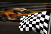 Orange Racing Car And Chequered / Checkered flag