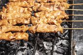 Tasty Charcoal Grilled Pork Skewer Sticks Sizzling On The Bbq Grill Outdoor,  Moo Ping, Thai Street  poster