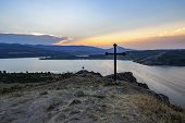 Impressive August Sunset Over Pchelina Dam In Bulgaria With Two Religious Crosses On The Rocks Next  poster