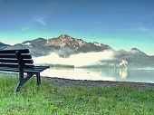 Bench Under A Tree On A Lake Shore. Mountains At Background. Take A Rest Near Blue Green Lake.  Beau poster