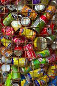 LISBON, PORTUGAL - OCT 1: Used aluminum cans are deposited into a container for recycling, this cont