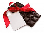 Black Chocolate with red ribbon and card. Isolated, clipping path