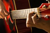 Acoustic Guitar Red, Dark Background, Sits The Musician Playing On Classical Spanish, Musical School poster