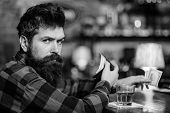 Rest And Relax Concept. Guy Spend Leisure In Bar, Defocused Background. Hipster Holds Wallet, Counti poster