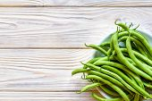 Green String Beans In A Bowl On White Wooden Table poster