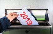 Happy New Year 2019. Hand Putting Mail With Number 2019 In Mailbox poster