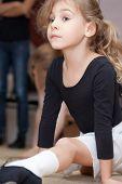 little girl carries out exercise - longitudinal splits