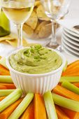 Guacamole With Carrot And Celery Sticks - Guacamole Topped With Fresh Green Chilli, With Carrot And  poster