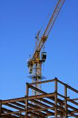 Cranes And Steel Building; Vertical Background