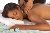 African-American Woman Getting Massage In Spa