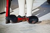 foto of evzon  - Details from the traditional costume of a presidential guard in Athens Greece - JPG