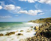 Sea Sky Stones.wave Winding Coastline Accrue At.
