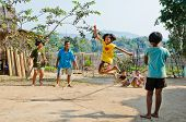 An Unidentified Children Playing Kra Dod Cheark (the Rope Jumping)
