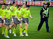 MELBOURNE - JUNE 30 : Umpires leave the ground after Collingwood's win over Fremantle on June 30, 2012 in Melbourne, Australia.