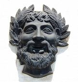 Carved Stone Face Of Bacchus In Relief With Shadow On Building In Lisbon, Portugal