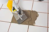 stock photo of mortar-joint  - Trowel puts adhesive on hole to repair it - JPG