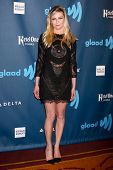 eLOS ANGELES - APR 20:  Kirsten Dunst arrives at the 2013 GLAAD Media Awards at the JW Marriott on A