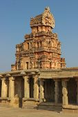 stock photo of krishna  - One of the towers of the Krishna temple in Hampi a village on the place of the great ancient city Vijayanagara - JPG