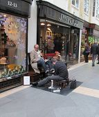 LONDON- APRIL 10: Concierge outside londons famous Burlington arcade. The oldest covered shopping ce