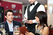 Couple ordering dinner in a restaurant
