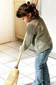 stock photo of cleaning house  - little girl helping to clean the house - JPG