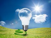 foto of cord  - Transparent light bulb floating in a green field with a green cord - JPG