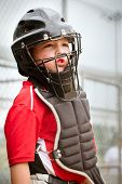 Portrait of child playing catcher during baseball game