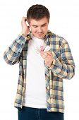 Young man a puzzled holding box with wedding ring, isolated on white background