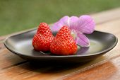 Strawberry In A Black Dish