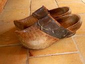 stock photo of clog  - Pair of vintage clogs with leather strap