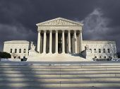 Dark forbidding troubled storm sky over the United States Supreme Court building in Washington DC.
