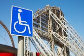 stock photo of olympic-games  - disabled access sign outside Khalifa sports stadium in Doha Qatar Middle East where the 2006 Asian games were hosted and location for the proposed 2016 Olympic Games  - JPG
