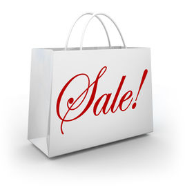 picture of cursive  - The word Sale in red cursive script lettering on a white paper shopping bag for a store holding a discount or special clearance event - JPG