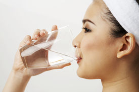 picture of drinking water  - close up of woman drinking water from a glass - JPG