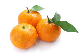 stock photo of mandarin orange  - Close up of mandarin oranges isolated over white background - JPG