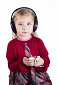 Little blonde girl smiling listening to music on smart phone mobile device