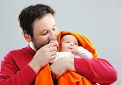 Happy father with newborn baby
