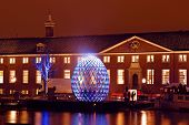 AMSTERDAM, NETHERLANDS - DECEMBER 07 2012: Illuminated Hermitage museum with in front a luminous egg, an element of the first edition of the Amsterdam Light Festival on DECEMBER 07, 2012 in Amsterdam.