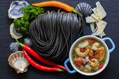 Italian cuisine - Fettuccine al nero di seppia with seafood