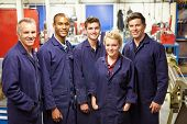 Portrait Of Staff Standing In Engineering Factory