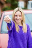 Teenage Girl Standing Next To Car Holding Key
